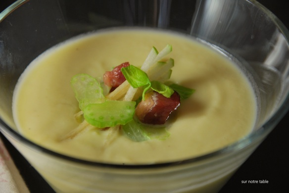 celery root and leek soup topped with celery, apples and bacon